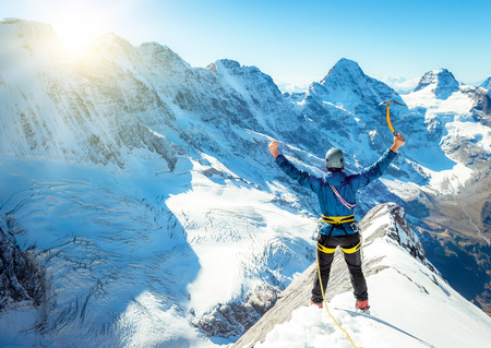 lead rope: Climber reaching the summit. Extreme sport concept Stock Photo