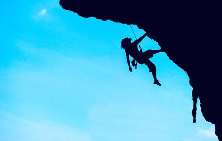 Sport extrême. Le grimpeur lors de la roche conquête. concept Extreme sport