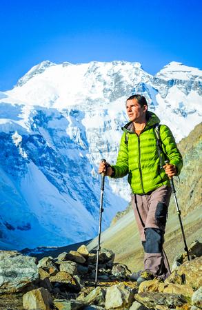 Hiker on the trek in Himalayas. Active sport concept