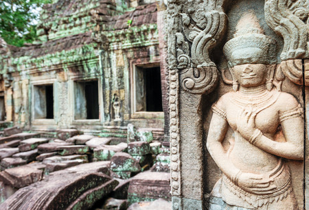 murals: Stone murals and sculptures in Angkor wat, Cambodia. Stock Photo
