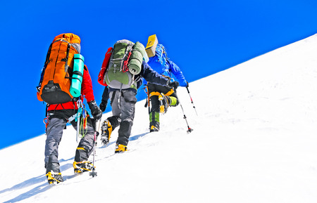 summits: Group of hikers in the mountains. Extreme sport concept