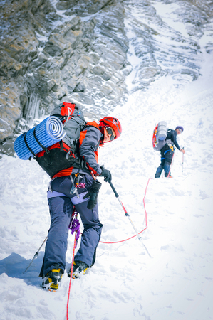 Group of climbers reaching the summit. Extreme sport concept 스톡 콘텐츠