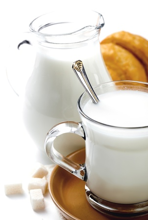 fresh milk in the jug and cup and croissant photo
