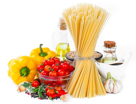 The composition of the pasta and vegetables on a white background  photo