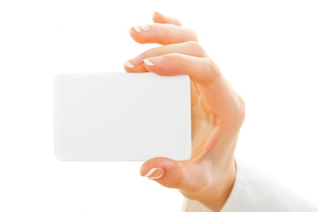 Female hand with a blank card isolated on white photo