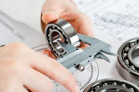 mechanical engineering: tools and mechanisms detail on the background of technical drawings