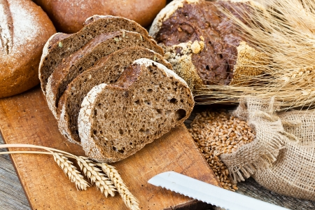 loaf: fresh bread and wheat on the wooden
