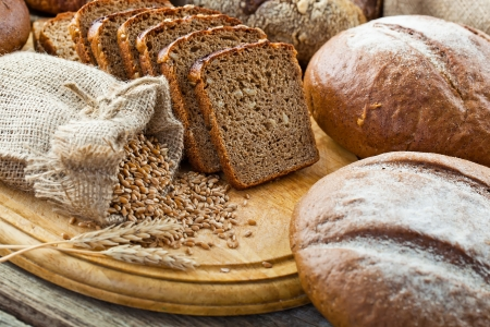 black bread: fresh bread and wheat on the wooden