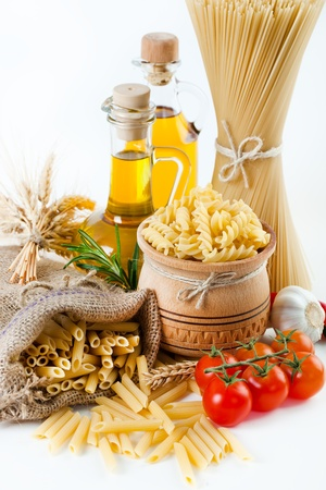 The composition of the pasta and vegetables on a white background