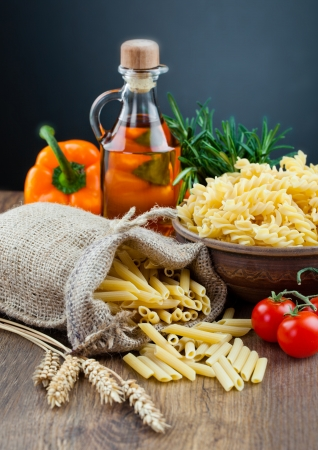The composition of the pasta and vegetables on background  photo