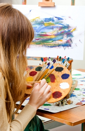 Girl Paints with brush photo