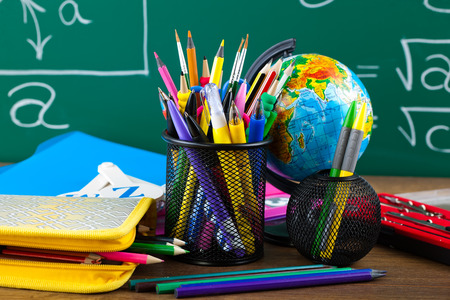 education background: Back to school blackboard with pencilbox and school equipment on table Stock Photo