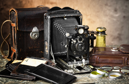 Old camera on an old background on a close-up table