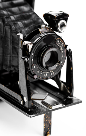 shutter aperture: Old camera on white background on a close-up table