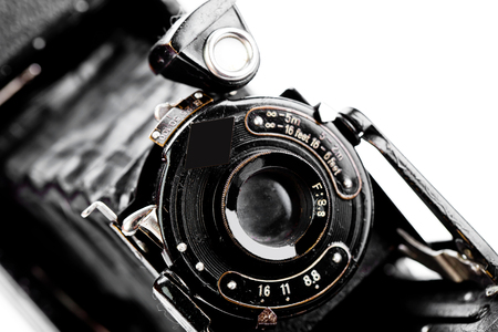 Old camera on white background on a close-up table