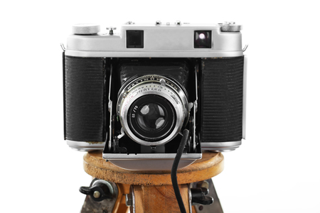 shutter aperture: Old camera on white background on a tripod close-up