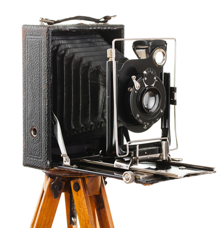 Old photo camera on white background, on the table, closeup Stock Photo