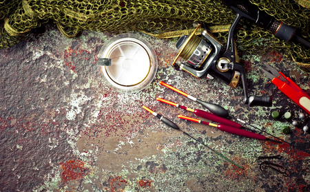 Fishing accessories in the composition on the table