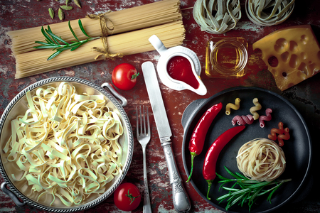 pasta in the composition on the table with objects for the kitchen