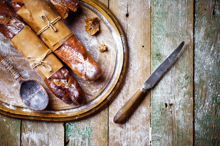 bread in composition with kitchen utensils