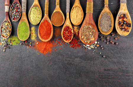 Spices for cooking with kitchen accessories on an old background Standard-Bild