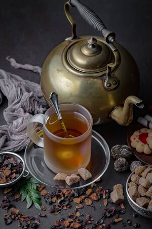 Tea hot drink on old background in composition on the table Stock Photo