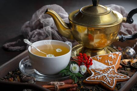 Tea hot drink on old background in composition on the table