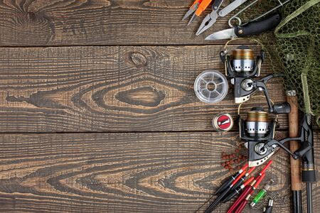 fishing tackle on a wooden table.