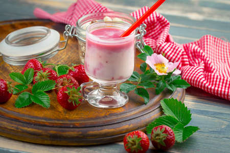 Sweet strawberry and healthy, wholesome food in composition on the table.