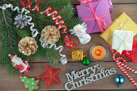 Merry Christmas, postcard with gifts and Christmas decorations. Imagens