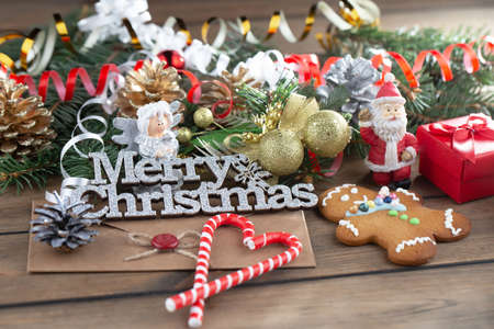 Merry Christmas, postcard with gifts and Christmas decorations.