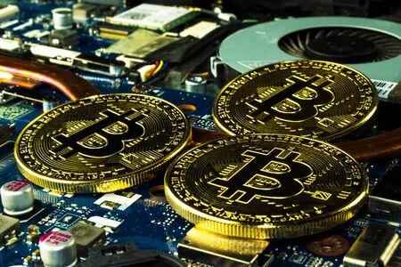 Bitcoin on a computer board.