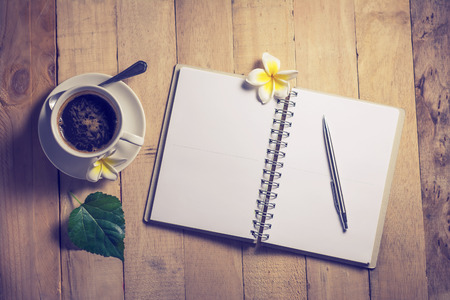 write: write a note to a notebook and a cup of coffee