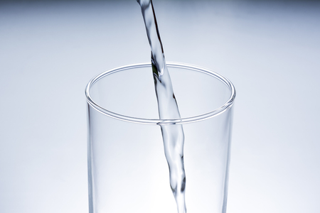 into: Pour water into a glass
