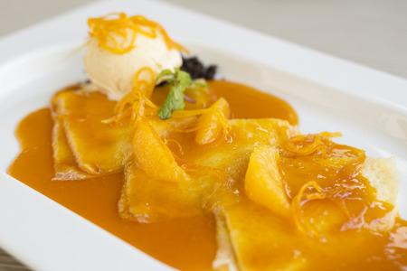 sue: Crepes with orange flavor Sue Seth vanilla ice cream.