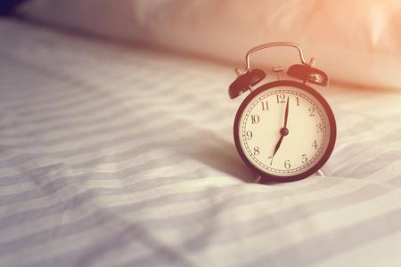 Alarm clock in bed
