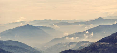Mountains covered with morning fog. Stock Photo