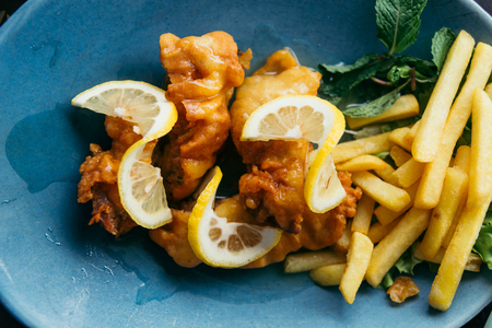 Fried chicken and fried with lemon sprinkles.