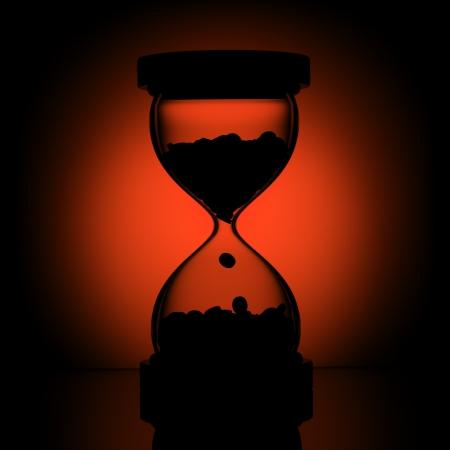 reloj de arena: silueta de tiempo Foto de archivo