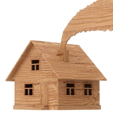wooden toy house with smoke isolated on white photo