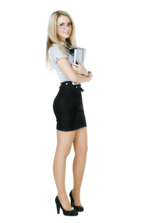 pretty business woman holding a folder and looks into the camera  Stock Photo