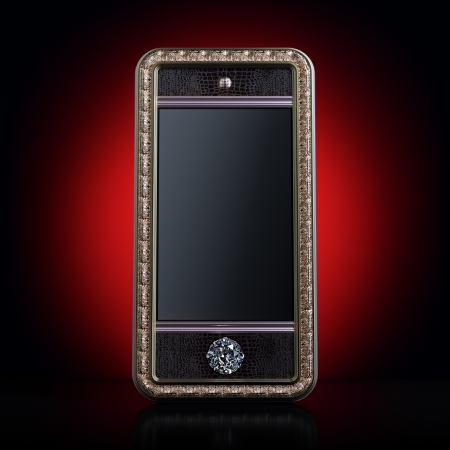 Exclusive golden mobile phone with diamond home button for VIP with black screen  version on red background   Iphone-style device photo