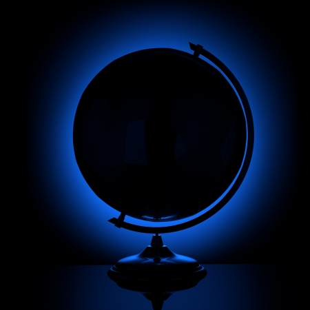 south east: silhouette of the globe on a blue background lighting  Stock Photo