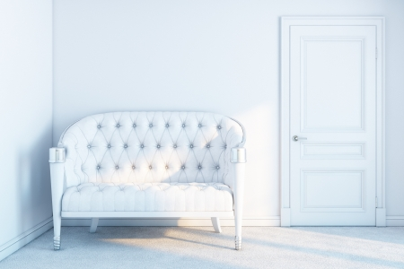 white leather sofa in a white empty room with sunrays