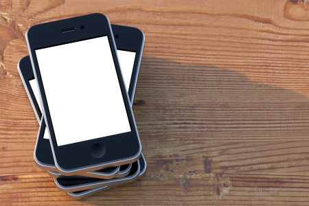 smartphones with touch screen technology on a wooden surface Stock Photo - 13883173