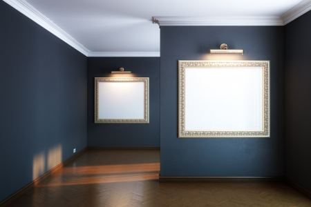 wall art: new interior gallery with wooden parquet and empty frames and lighters  black walls  version  Stock Photo
