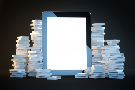 touch screen pad on a black background among the many paper books
