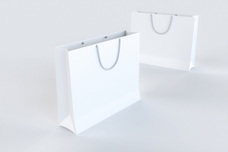 Empty Paper Shopping Bags on white surface photo