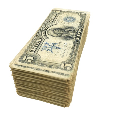 stack of vintage American money isolated on white background photo