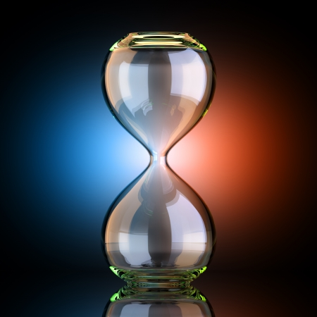 hourglass: Empty Sand Clock In Black Studio With Artistic Backlight Stock Photo
